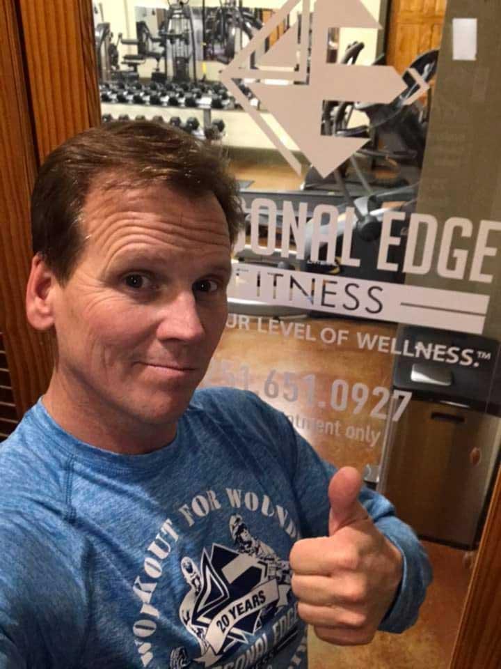 Garrett in front of the door at Personal Edge Fitness Eastern Shore