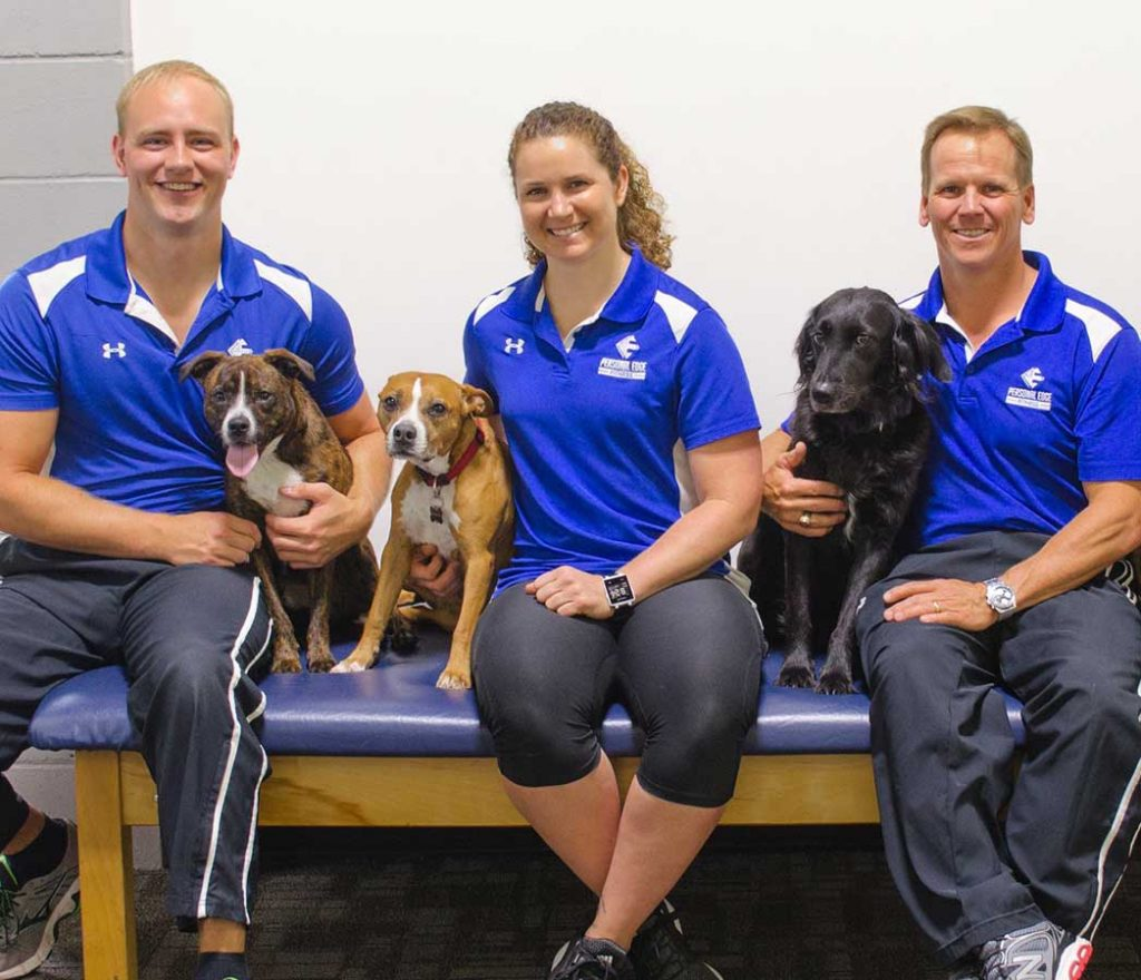 Personal Edge Fitness trainers and their dogs